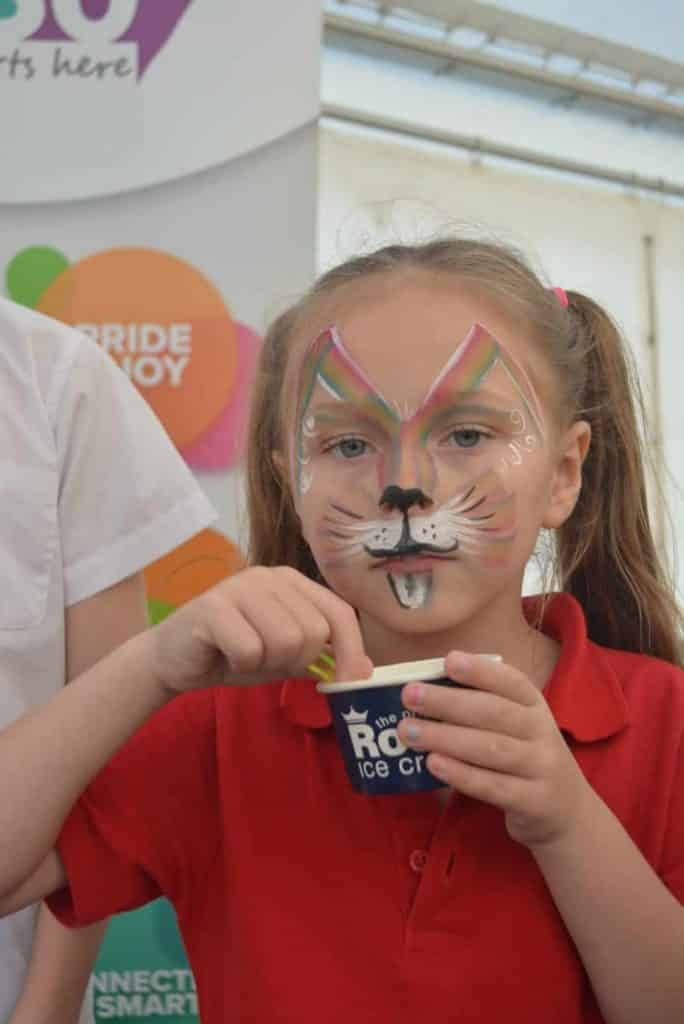 Photo of girl enjoying ice cream at the Better Queensway regeneration launch event